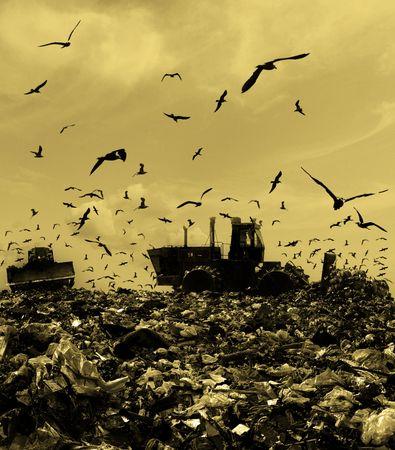 Die Bulldozer begräbt Essen und industrielle Verschwendungen