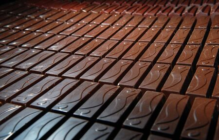 delightfully: Chocolates, brown background