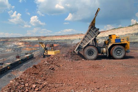 Dump-body truck unloading in mine of iron ore Stock Photo - 5562095