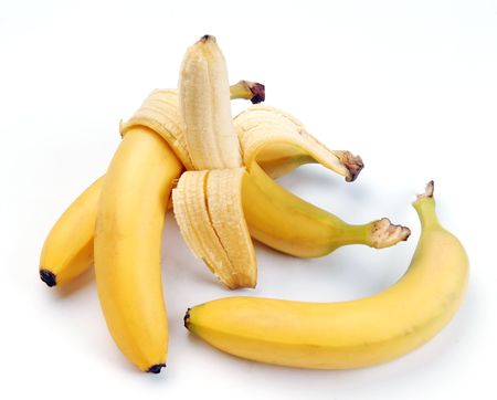 cleared: Ripe bananas and one half cleared on a white background
