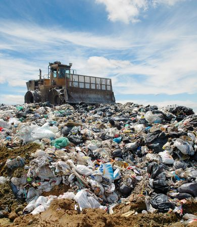 fills: The bulldozer buries food and industrial wastes