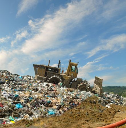 wastes: The bulldozer buries food and industrial wastes