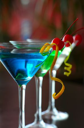 Classical martini with berries of a cherry of blue green and beige color