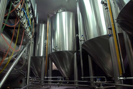 fermenting: Steel tanks for beer manufacture in brewery