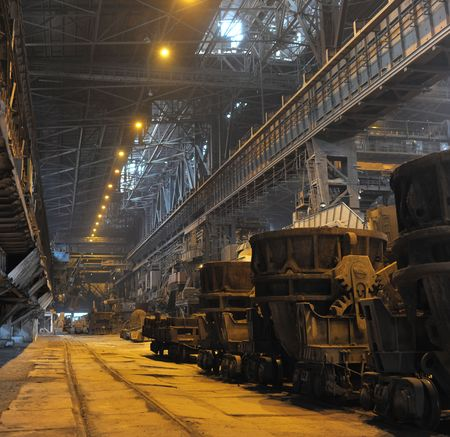 Shop of metallurgical industrial complex with ladles on a railway platform Stock Photo