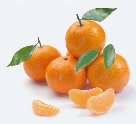 clementines with segments on a white background photo