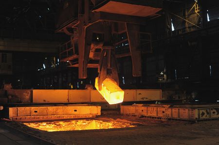 fused: The heated steel pigs the crane from takes out furnaces Stock Photo