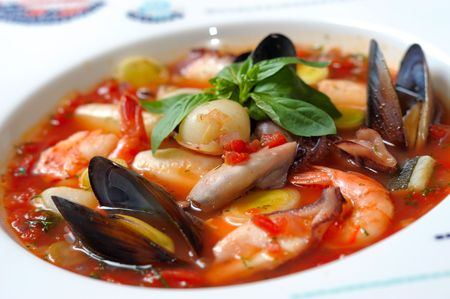 mussel: Tomato soup with seafood and fish in a plate Stock Photo