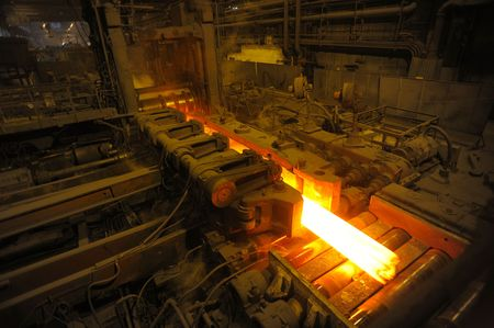 metallurgy: The heated steel pigs on the rolling mill Stock Photo