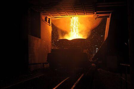Liquid metal from casting ladle. Ferrous metallurgy. Stock Photo - 6379495