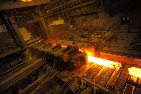 fused: The heated steel pigs on the rolling mill Stock Photo