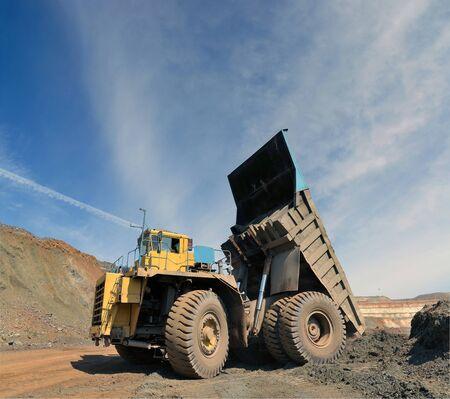 unloading truck in a career of iron ore Archivio Fotografico