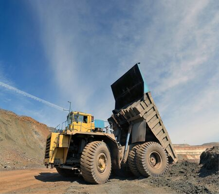unloading truck in a career of iron ore Stock Photo