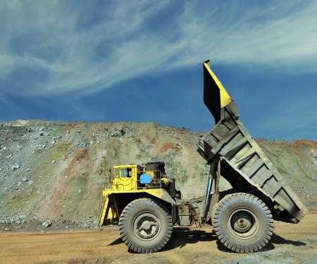 open cast mine: unloading truck in a career of iron ore Stock Photo