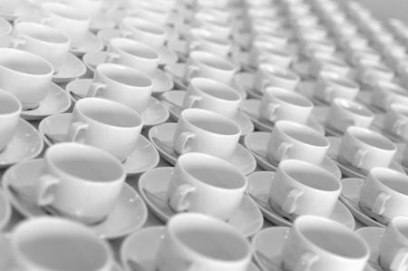 bar ware: Tea cups standing among on a white bar rack Stock Photo