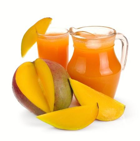mango juice in a jug and a glass of fruit Stock Photo - 10020300