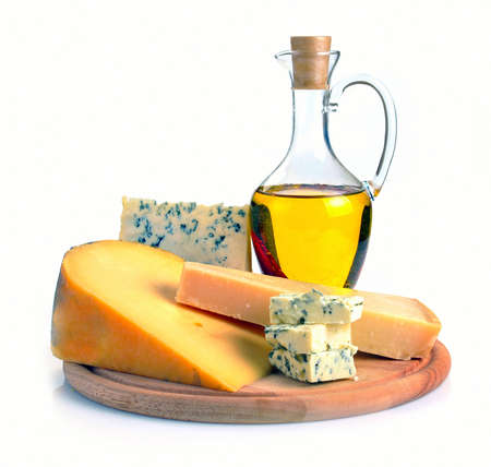 parmezan: collection of cheeses and olive oil on a wooden board Stock Photo