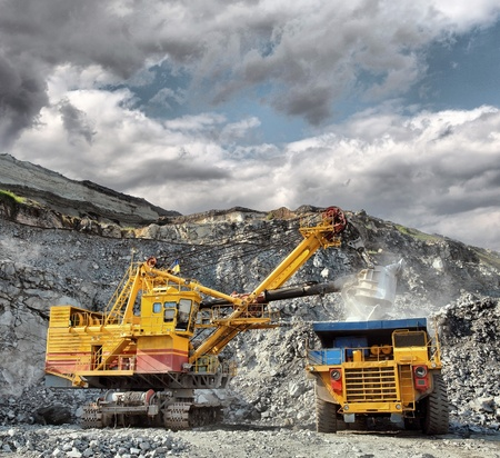 mine: Loading of iron ore on very big dump-body truck Stock Photo