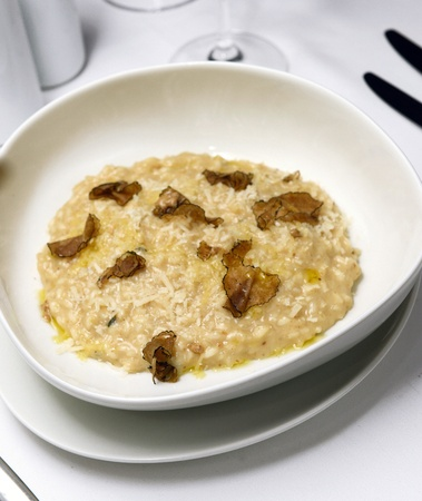 white truffle: risotto with truffle over white dish Stock Photo