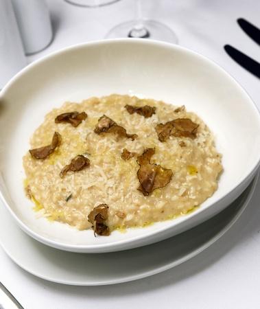 risotto: risotto with truffle over white dish Stock Photo