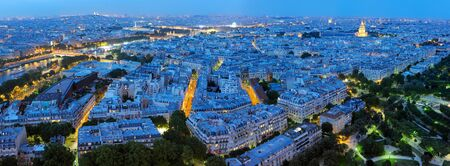 urban decline: Night panorama of Paris from the height of the Eiffel Tower