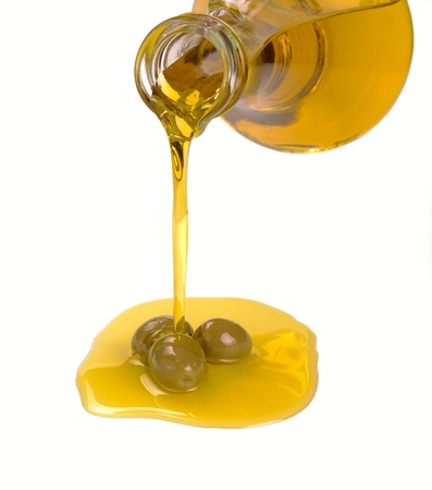 olive oil pouring from a bottle Stock Photo