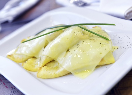 crepes with cheese and white mushroom and baked with grated cheese