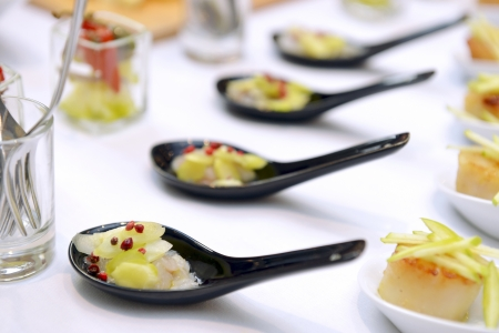 amuse: scallops in the spoon on the buffet table