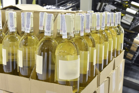 vintages: white wine in bottles in wine shop