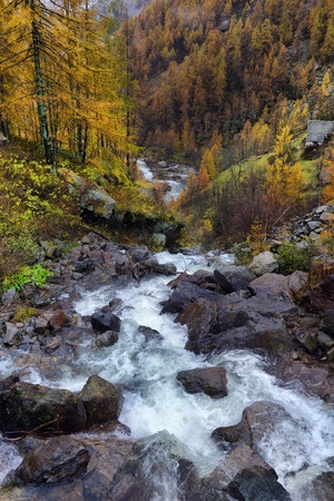 water fall: autumn landscape in the Alps