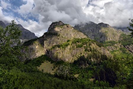 svan: mountain landscape in Georgia, road and clouds