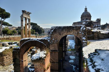 ROME. ITALY. FEBRUARY 27 2018 Ancient Roman ruins in Rome. In winter, under the snow, ROME. ITALY. FEBRUARY 27 2018