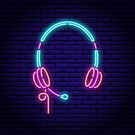 Computer headphones. Neon sign on a brick wall background. Blue violet red colors