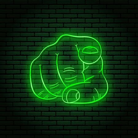 Neon sign with a green glow. Hand gesture, index finger pointing at you. On a brick wall background, for your design.