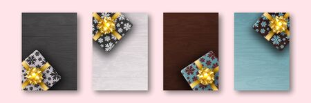 A set of four a4 format leaflets. Gift box is Packed in wrapping paper with painted snowflakes. Gold ribbon and bow in form of flower. Against the background of boards of different colors.