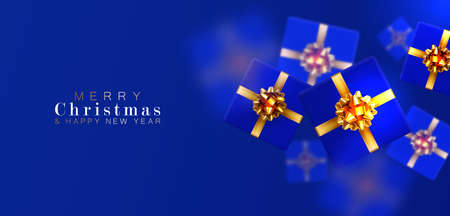Gift box with motion blur effect. Merry Christmas and Happy New year. Realistic background with voluminous blue gifts tied with a gold ribbon with bows. The view from the top. Horizontal arrangement.