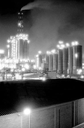 smokestacks: Air pollution in a oil refinery in Tarragona, Spain Stock Photo