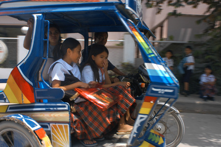pinoy: Tut tuc. Moto-taxis, Carretera Central Boracay.  Editorial