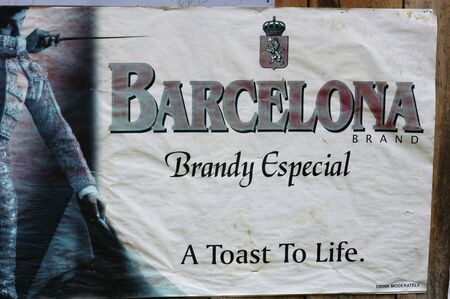 brandy: Barcelona brandy. Advertising of a bullfighter. Bohol. Philippines. A toast to life. Stock Photo
