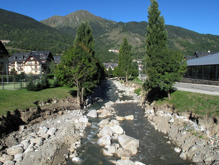 Landscape in Vielha near the tunnel of Vielha, road N 230, Vielha e Mijaran, Viella, Val dAran, Aran Valley, Pyrenees, Lleida province. View of mountains, town centre, river and Vielha small lake photo