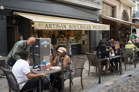 Artisan Boulanger Pastissier bar restaurant. Pedestrian shopping street in old city central Narbonne. South of France.