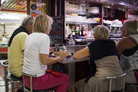 wine trade: Narbonne, market restaurants. France. Much more than a market, the Narbonne Halles are one of the nerve centres of the city.