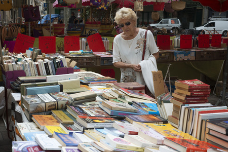 bric: Narbonne Market. France. Shop selling books ahead of the market.