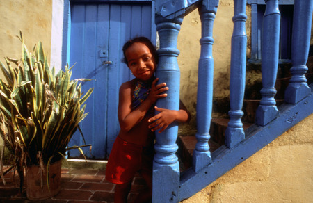 colonial house: Portrait of a girl in a colonial house, Trinidad, Cuba.