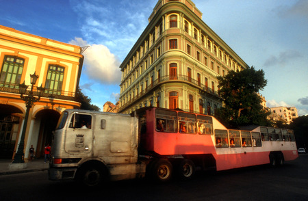 old bus: Old bus truck called camello passing the Saratoga Hotel, Paseo de Marti, Old Havana, Cuba