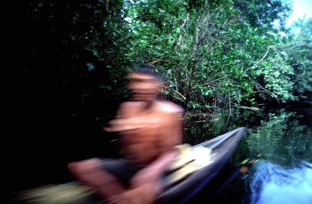 unitary: A boat in the Orinoco River. The Warao are an indigenous people inhabiting northeastern Venezuela and western Guyana. Alternate common spellings of Warao are Waroa; Guarauno; Guarao; and Warrau. The term Warao translates as the boat people;  after the W Stock Photo