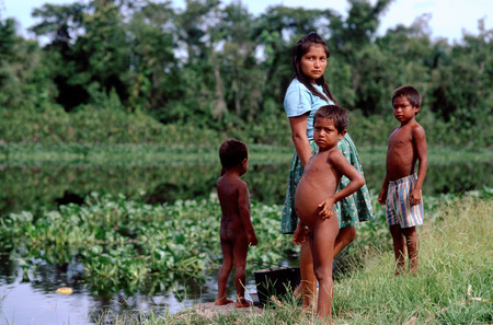 translates: A family of Warao Indians in the Orinoco delta. The Warao are an indigenous people inhabiting northeastern Venezuela and western Guyana. Alternate common spellings of Warao are Waroa, Guarauno, Guarao, and Warrau. The term Warao translates as the boat pe