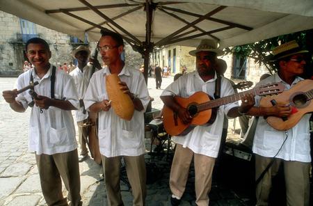 Musicians Play Cuban Rhythms on the Streets of Havana. Music, Old Habana, Cuba. Music band playing outside a restaurant, Havana (Habana), Cuba, Caribbean.
