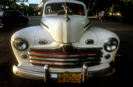 capitolio: Old car 1950s Chevrolet in front of Capitolio Nacional, Havana, Cuba