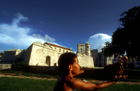 habana: Boy playing baseball in Morro fortress. Old Habana, Cuba. City skyline from El Castillo del Morro, Havana, Cuba, West Indies, Central America.